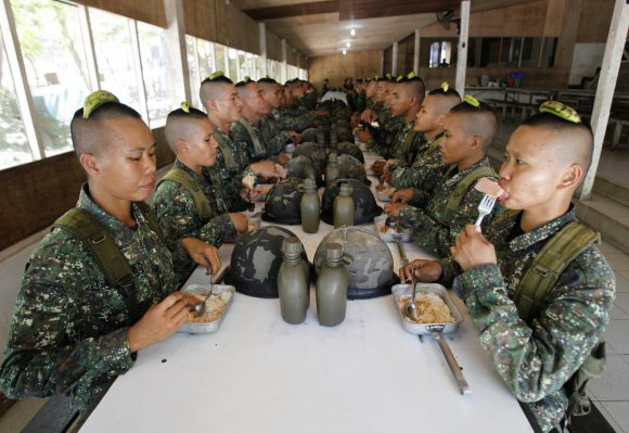 maintaining-posture-and-balance-is-another-part-of-a-soldiers-formation-these-philippines-recruits-have-to-hold-a-banana-on-their-heads-while-eating-lunch-if-the-banana-falls-they-have-t