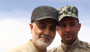 Iranian Revolutionary Guard Commander Soleimani stands at the frontline during offensive operations against Islamic State militants in the town of Tal Ksaiba in Salahuddin province