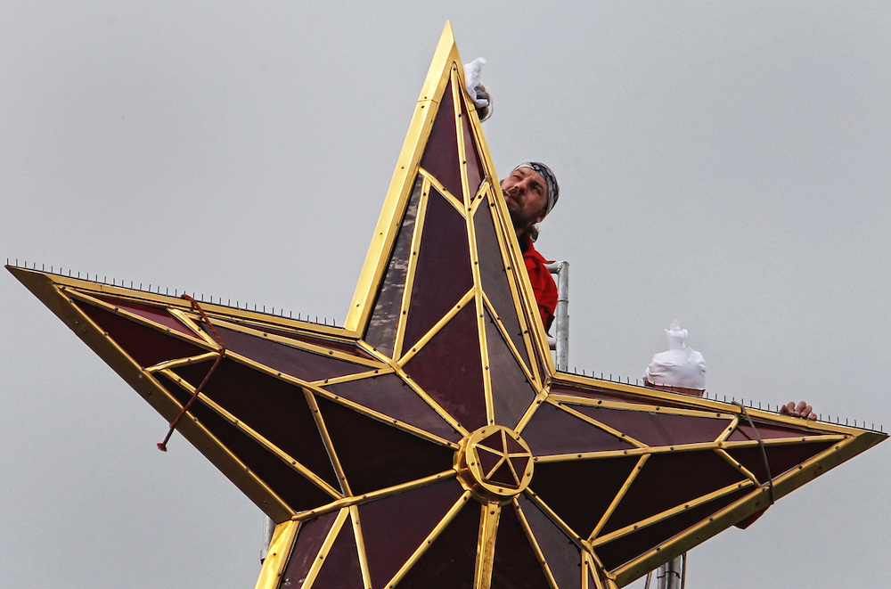 Workers cleaning the star on the top of Vodovzvodnaya tower of Moscow Kremlin