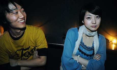 Japanese man and woman lean away from each other