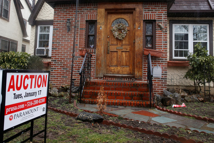 A childhood home of U.S. President-elect Donald Trump is seen with an auction sign in the Queens borough of New York
