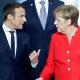Merkel Párizsban és csapdában