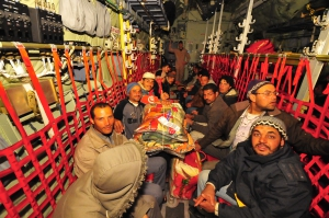 U.S. Forces fly refugees from Tunisia
